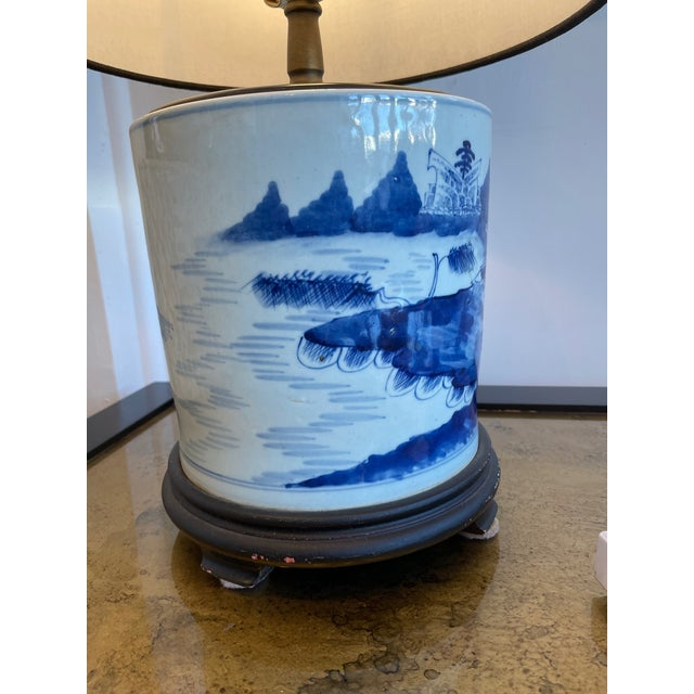 Antique porcelain table lamp painted image of a village landscape in classic blue color. Simple cylindrical form...