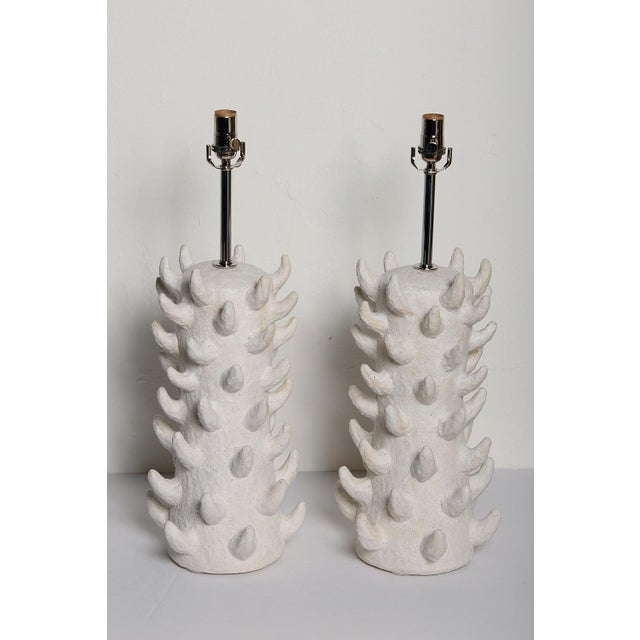 Pair of custom white salt-glazed stoneware lamps, handcrafted exclusively for Stripe by ceramicist Priscilla...