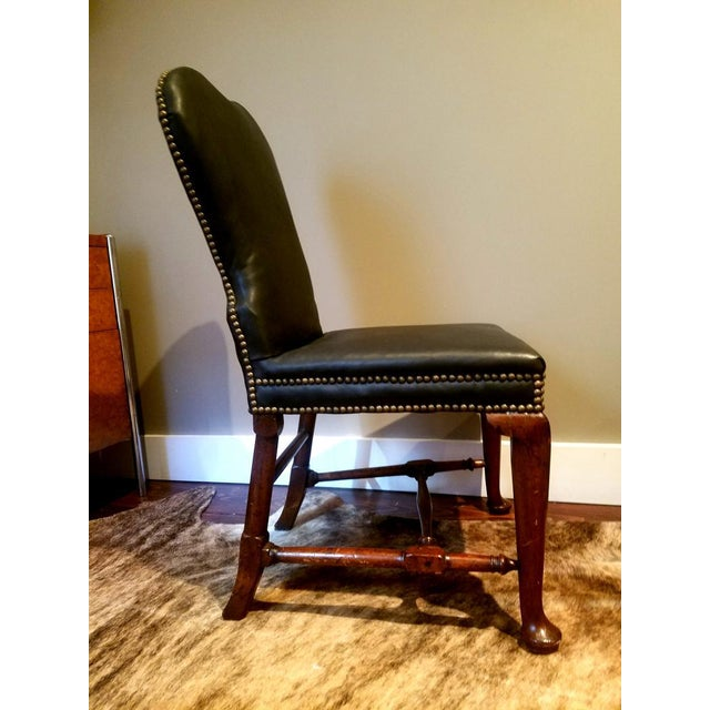 Beautiful and comfortable, this walnut upholstered chair with cabriole legs, yoked crestrail and delicate block and turned...