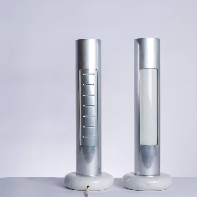 "Beautiful pair of ""Morgana"" table lamps by Enrico Panzieri for Sormani. Aluminum external revolving body allow to use..."
