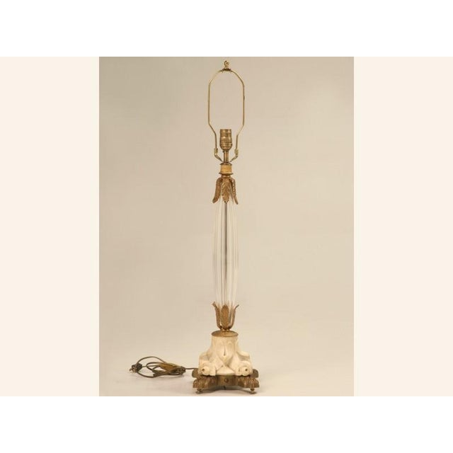 Unbelievable vintage French table lamp steals the show with its dynamite good looks. Resting on bronze paw feet the carved...
