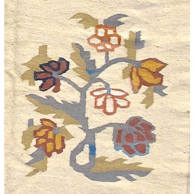 With its field of alternating shrubs or trees in bloom, this Bessarabian Kilim has a design almost more reminiscent of...
