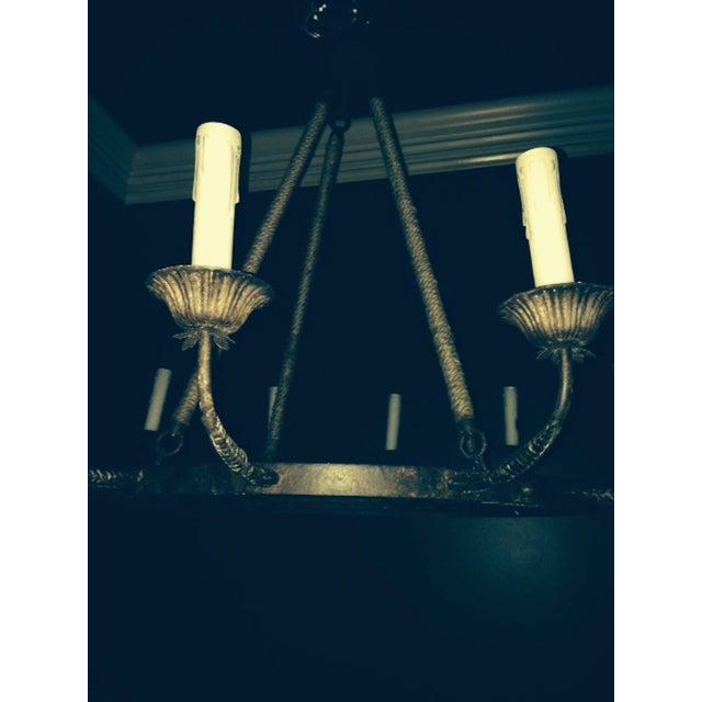 One pair of twelve-arm metal chandeliers of impressive scale. Priced per chandelier.