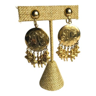 1980s Vintage Round Gold Tone Metal Earring With Dangle Ballerina Accents For Sale