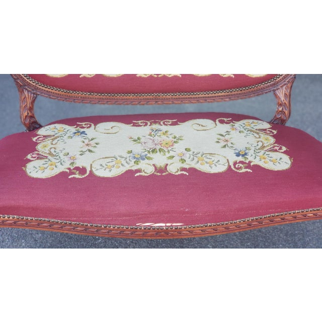 Description: This is a very good carved wood frame French Louis XV style living room or bedroom settee, c1950s. Wine...