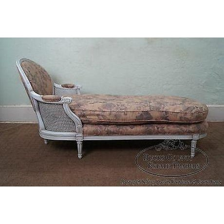 High quality, solid wood frame, painted chaise lounge w/ caned back & down filled cushions.