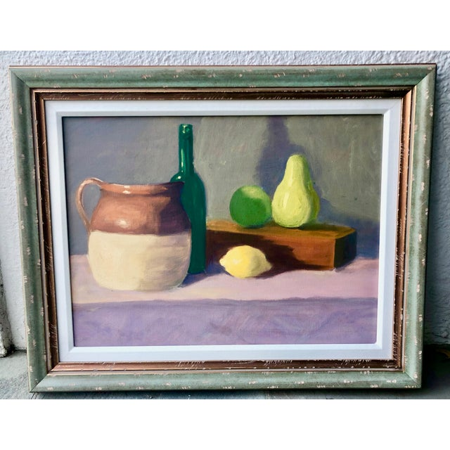Colorful and loosely rendered oil painting of a still life with fruit and pottery. Signed illegibly and has a written...