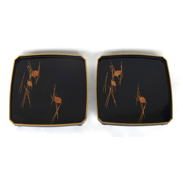 A lovely elegant pair of Japanese lacquer stacking footed trays circa 1930s-1950s Showa era. Japanese lacquered wood with...