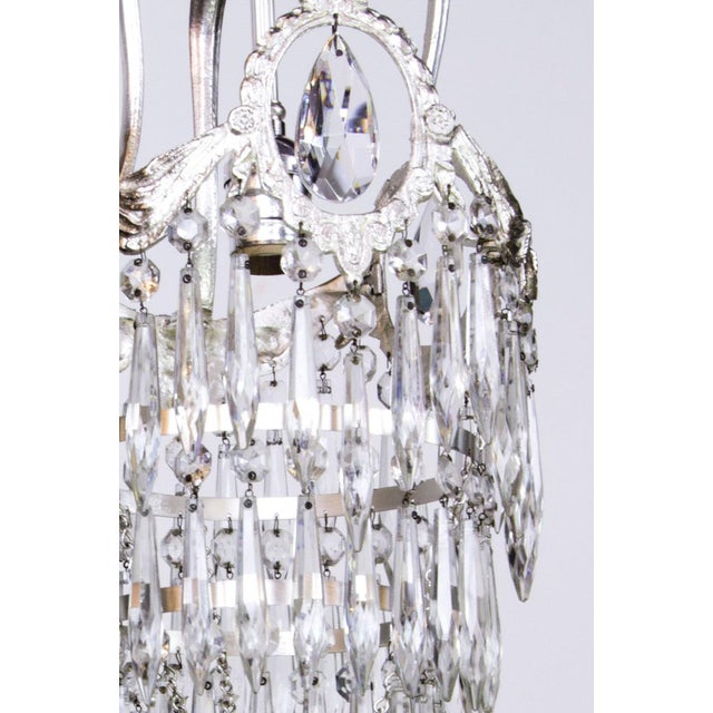 Silver plate fixture with crystal. Completely restored and rewired, ready to hang. Has a single bulb. C. 1920