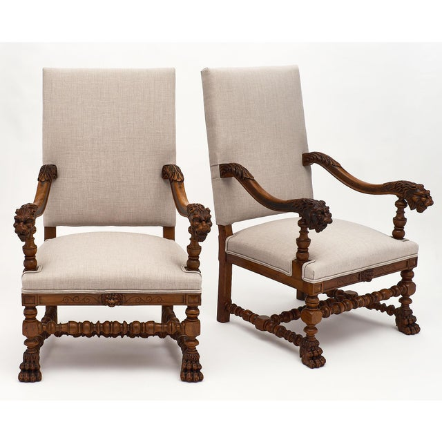 Louis XIII style French armchairs made of finely hand-carved walnut. We love the intricate details of the lion heads on...