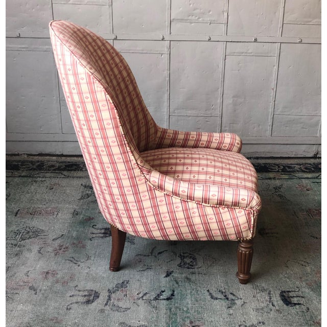 A charming small lady's slipper chair recently upholstered in a pattern fabric. The chair is in very good condition. Front...