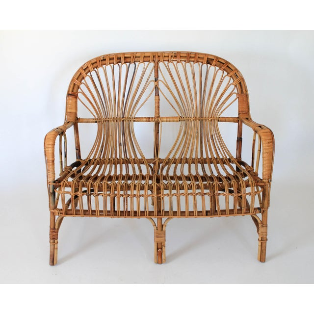 Mid-century bamboo loveseat in the style of Franco Albini. No makers mark. Some wear to middle front foot. Does not affect...