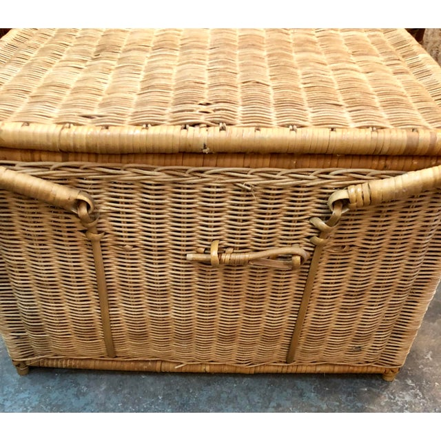 Vintage French flea market find, rattan with leather details and handles Picnic basket or small trunk.