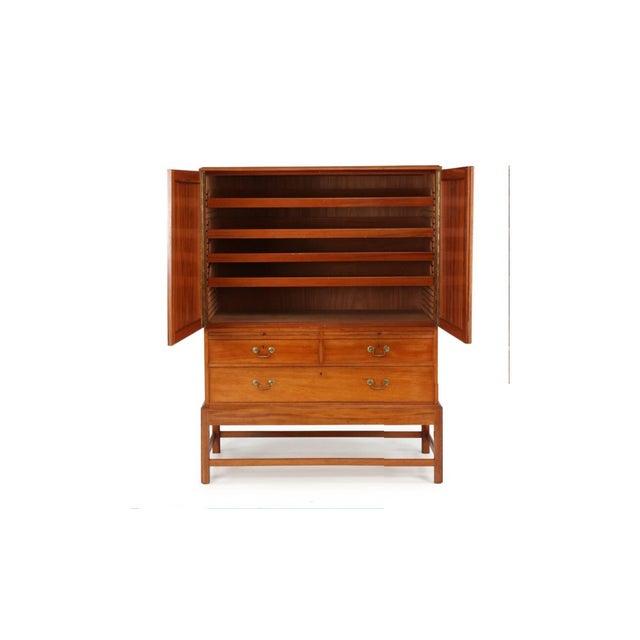 Kaare Klint, Danish midcentury cabinet in mahogany for Rud Rasmussen cabinetmakers, Copenhagen. Cabinet features a pair of...