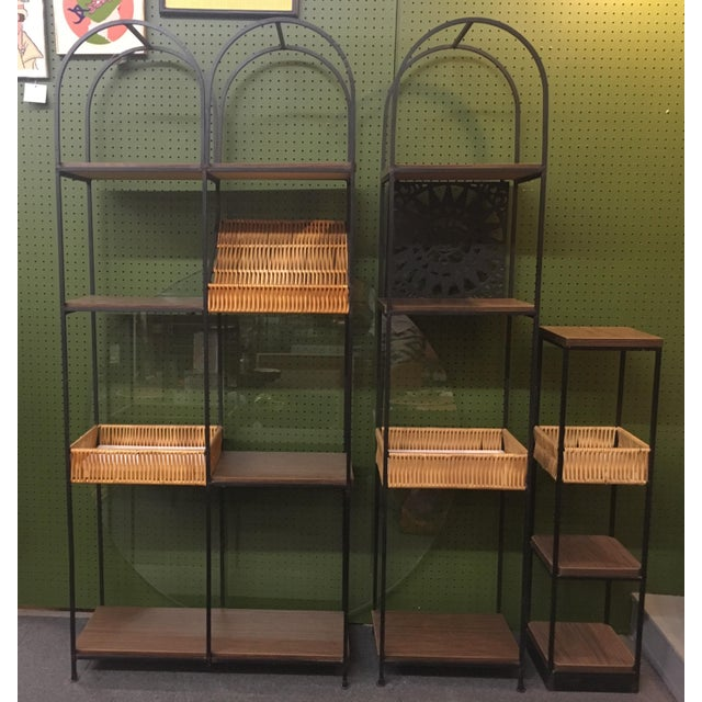 Awesome Arthur Umanoff etageres in excellent condition. A set of three Umanoff shelving units, one with the 'Mayan Sun'...