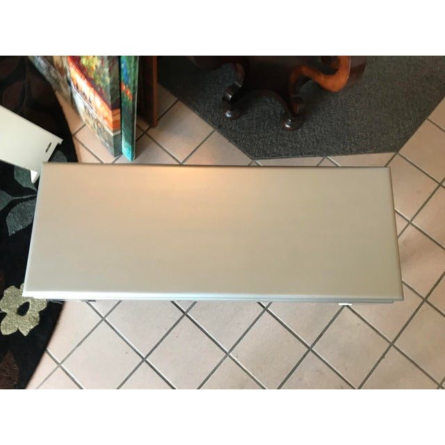 Professionally re-finished cocktail table in a silver sheen. Submitted by #AWhitePenguin