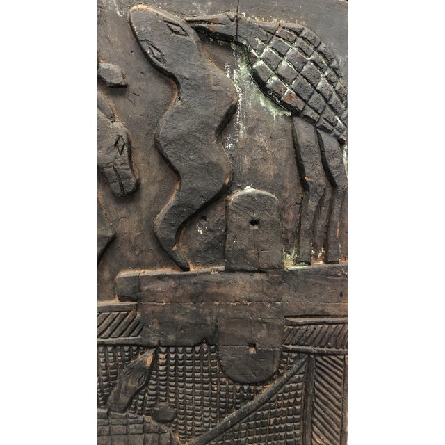 Primitive carved African wood panel. Vintage circa early 20th century.