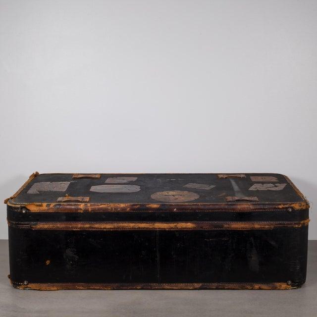"""ABOUT This is an original antique luggage. The luggage is covered with travel stickers that include """"Amstel Hotel..."""