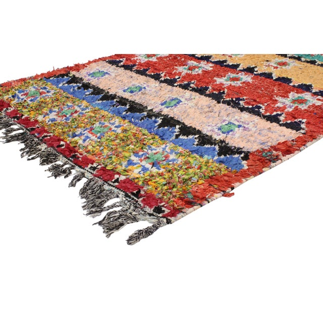 This vintage Berber Moroccan Boucherouite rug is one of a kind, as it projects vivacious color, intricate geometric...