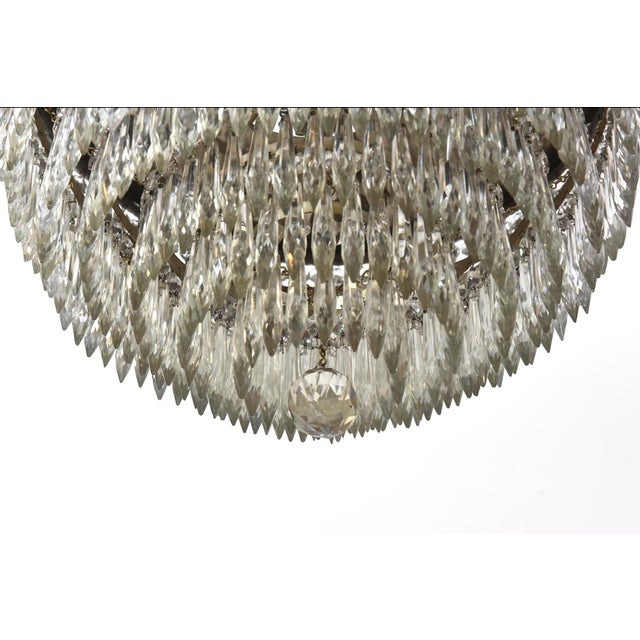 Tiered crystal chandelier with four lights. American. C. 1920.
