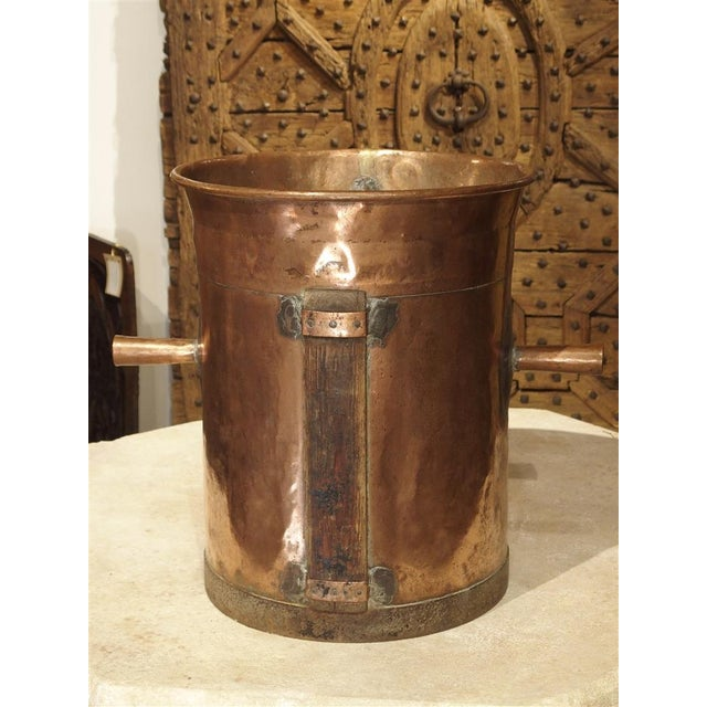 This beautiful copper object was a measuring and dispensing device used by a French wine producer around 1850. The...