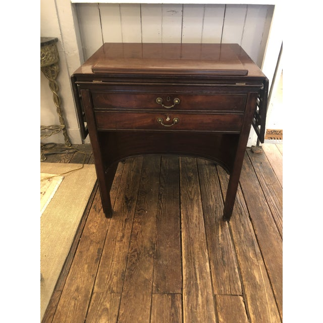 Marvelously designed versatile architect's desk that can be used as an elegant console with fretwork drop leaves, as a...