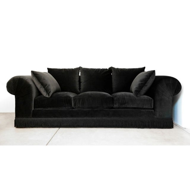 Dark, mysterious, and so fab! A stunning black velvet roll arm sofa with fringe. This is an absolutely top-of-the-line...