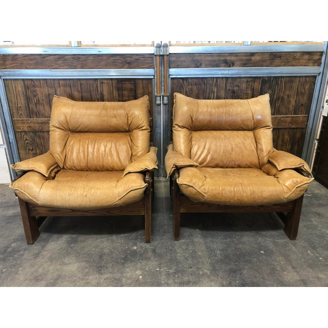 1970's Swedish Lounge Chairs with oak base and leather upholstery.
