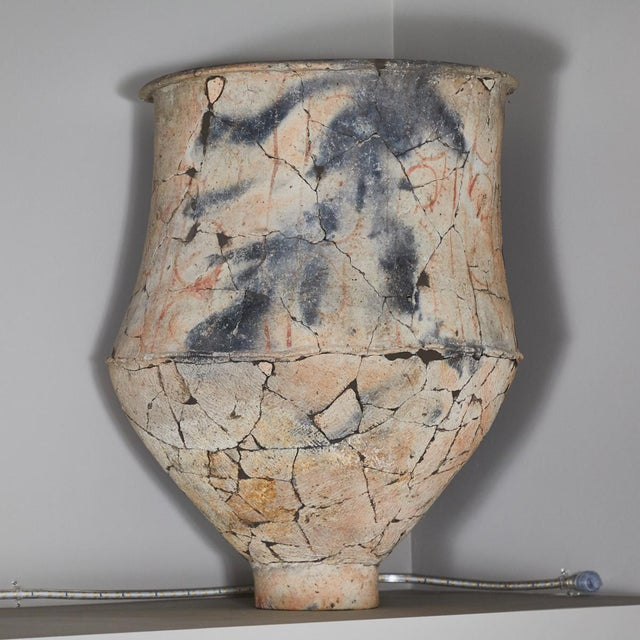 A cracked blackware urn from the north east Khorat plateau.