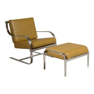 Chromium Steel Cantilevered Armchair and Ottoman, 1970s For Sale