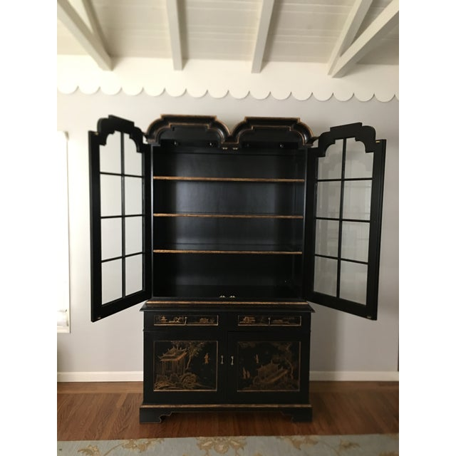 The meticulous detail of the hand painted Chinoiserie design on the doors and sides of this piece are truly unique - this...