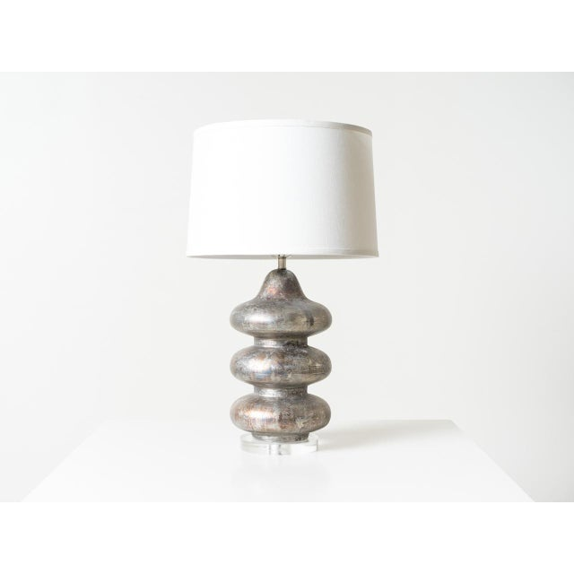"Pagoda table lamp. Sapphire and silver texture finish internal and external. Natural linen shade H 11"" x 16"" Top x 17""..."