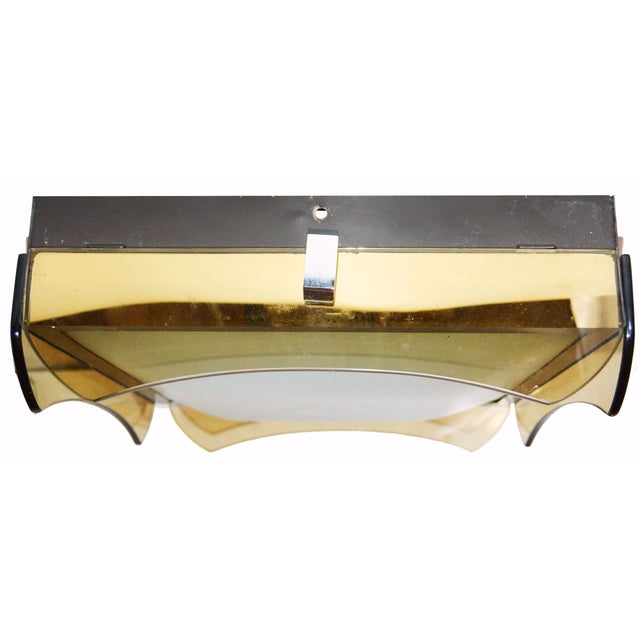 Offered is an Italian flush mount light, circa 1970s. This stunning piece features a square form with amber glass trim,...