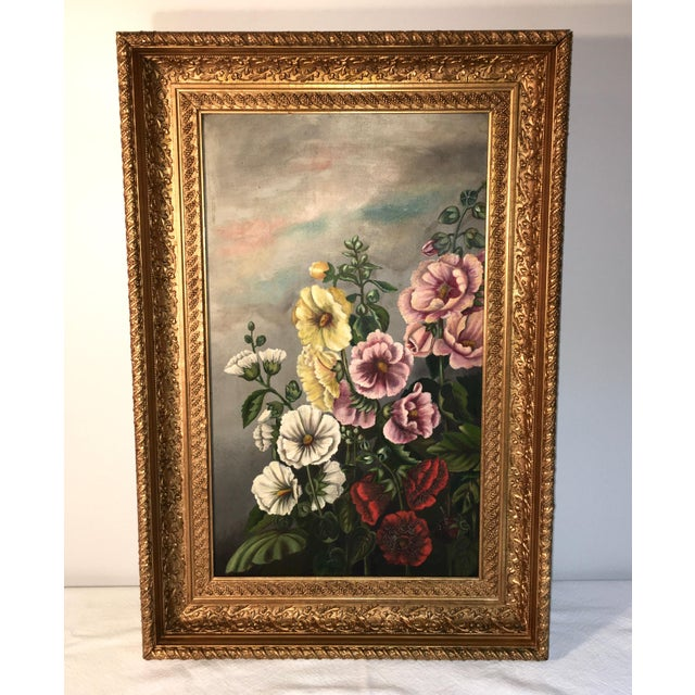 Antique painting of flowers in a recessed wood and plaster frame. Both will show signs of age and use. The painting has a...