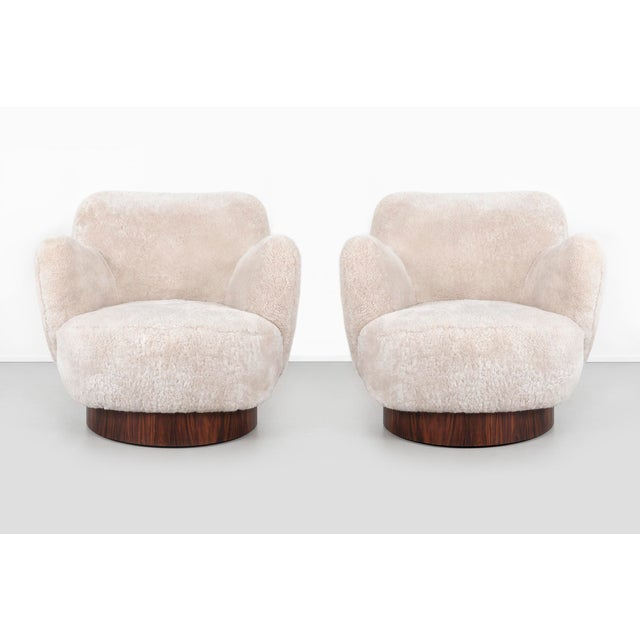 Set of two swivel chairs designed by Vladimir Kagan for Directional USA, c 1970s reupholstered in shearling + rosewood 28...