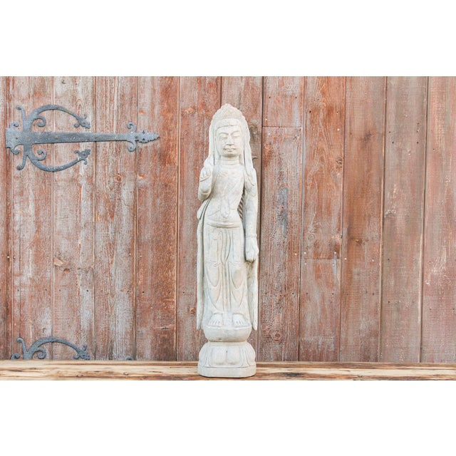 Beautiful limestone Quan Yin sculpture also known as Buddha of compassion. Quan Yin, Bodhisattva, is associated with...