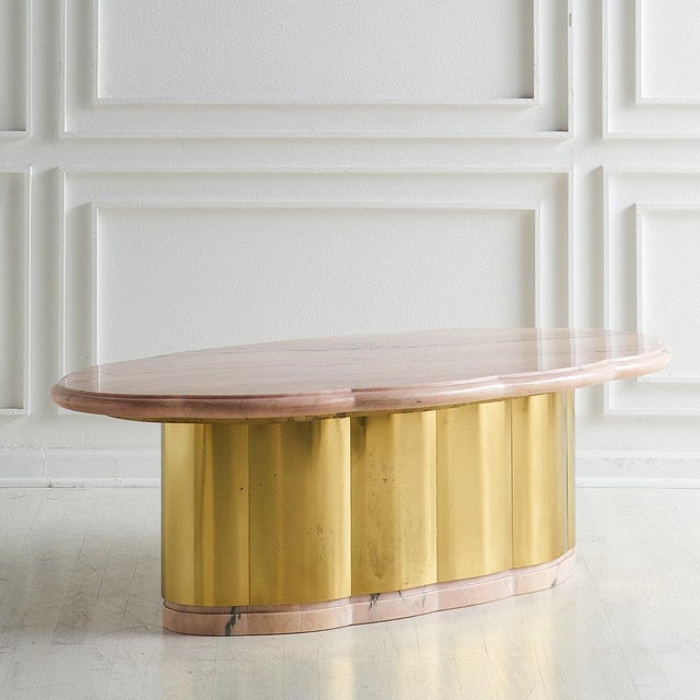 A unique pink marble top coffee table with a beautiful scalloped, beveled and polished marble top with a scalloped warm...