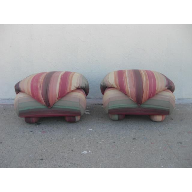 Pair of upholstered poofs with upholstered round feet has extra stuffed top with button details and equally plush base....