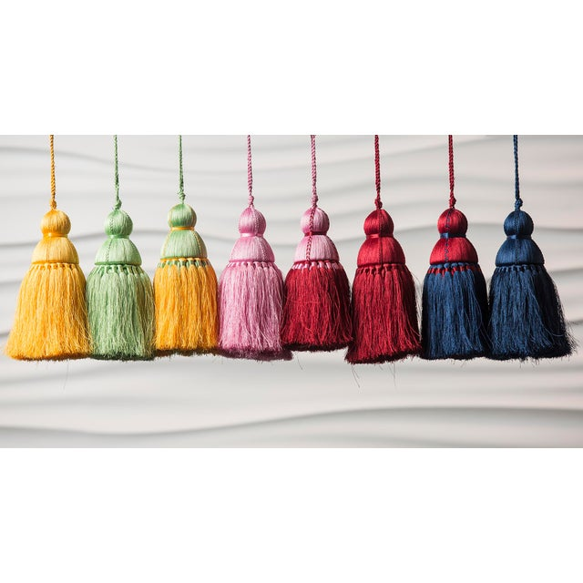 Reinventing the classic tassel in a modern way. Made from soft nylon threads, this Pink and Red color tassel will serve as...