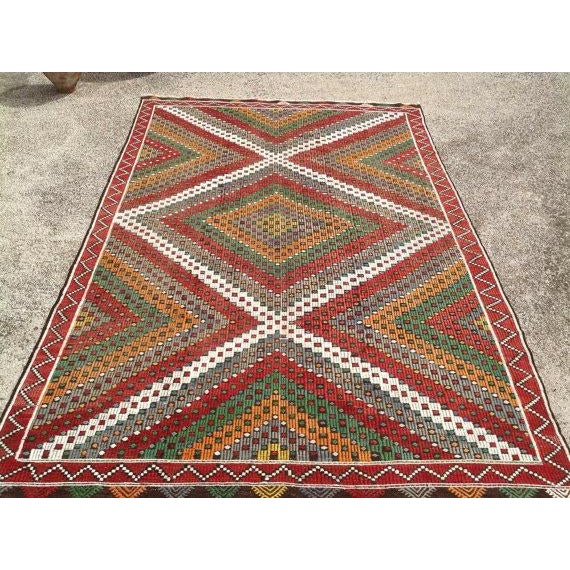 This beautiful, vintage, handwoven kilim is approximately 60 years old. It is handmade of very fine quality hand spun wool...