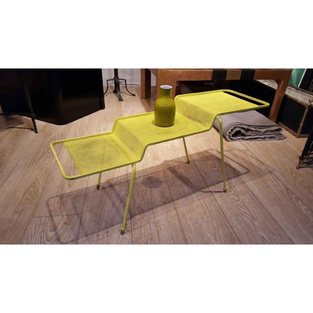 Mathieu Mategot coffee table in yellow painted iron and rigitule.