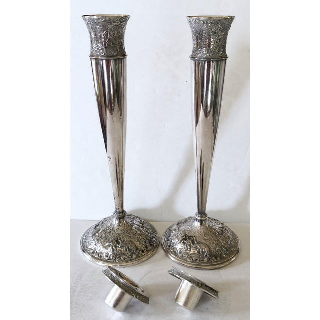 Barbour Silver Company is from Hartford Connecticut. This pair of silver plated candlesticks are fashioned with heavily a...