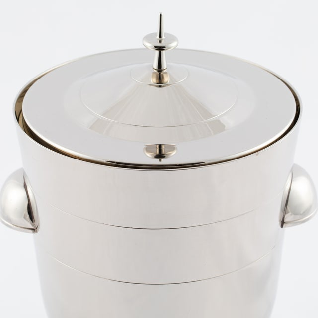Lovely mid-century ice bucket with incised ring designs by Tommi Parzinger for Dorlyn-Silversmiths. Newly re-plated in...
