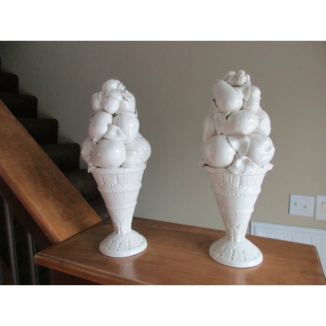 Here is a beautiful pair of Italian style fruit topiary candle stick holders. The set has a monochromatic white glaze...