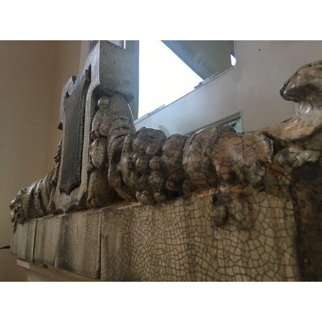 This 3 piece stone mantel is a salvaged architectural element from a library in Rhode Island from the 19th Century.