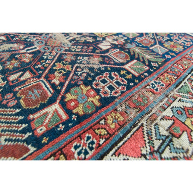 A gorgeous antique distressed runner with its densely abstract designed and closely geometric motifs in various colors...