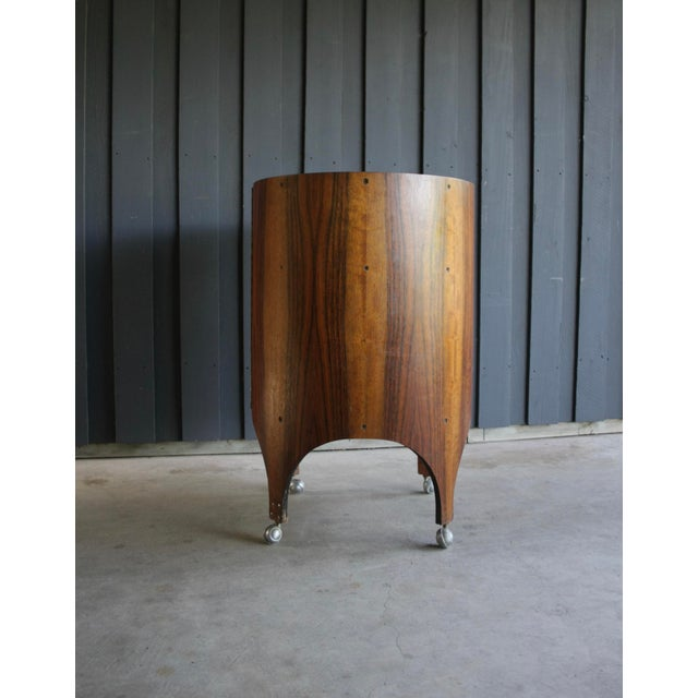One of a kind, handmade, bentwood, rosewood bar cabinet, with design attribution to Henry Glass. This is a truly...
