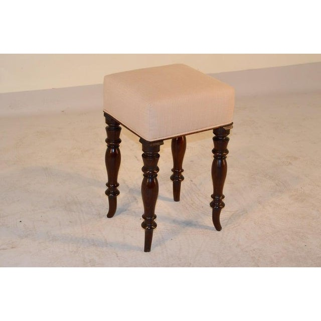 19th century English stool made from mahogany and newly upholstered in linen. Hand-turned legs with nicely splayed feet....
