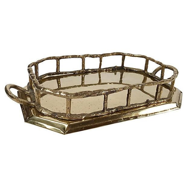 Petite octagonal brass tray with bamboo-style rail and handles. Charming patina to brass.