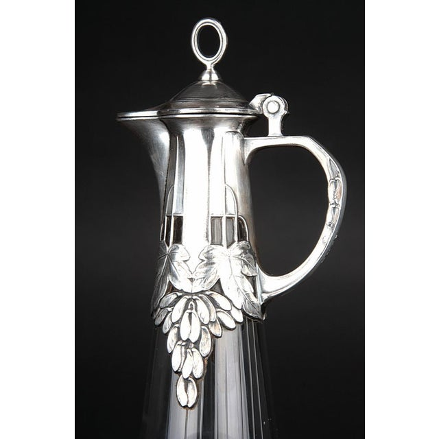 This great art nouveau pitcher was made by WMF in Germany between 1900-1910. It is made of thick hand-blown glass and...
